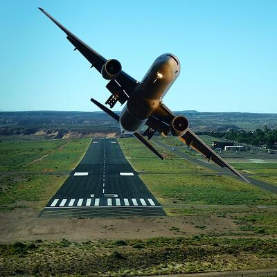 Pilot a plane taking off from a runway