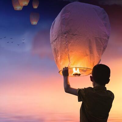 Light a sky lantern into the night sky