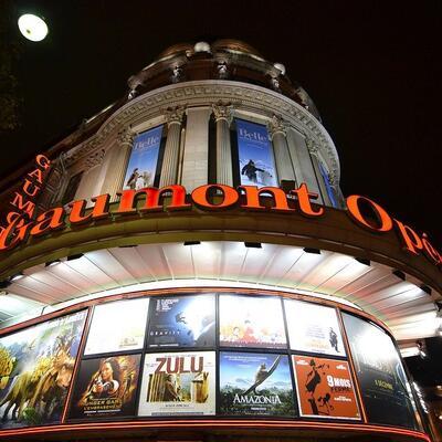 Attend the midnight screening of a blockbuster movie