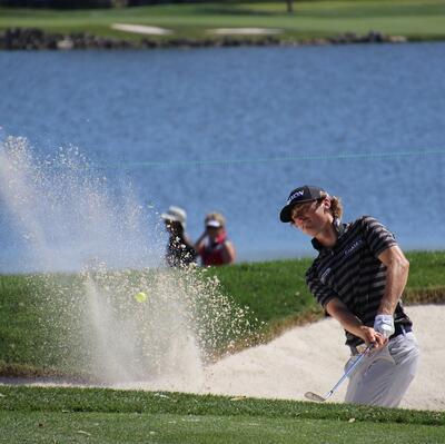 Master a bunker shot (golf)