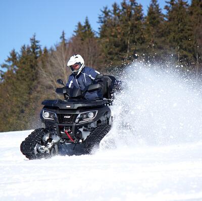 Ride a quad bike through snow