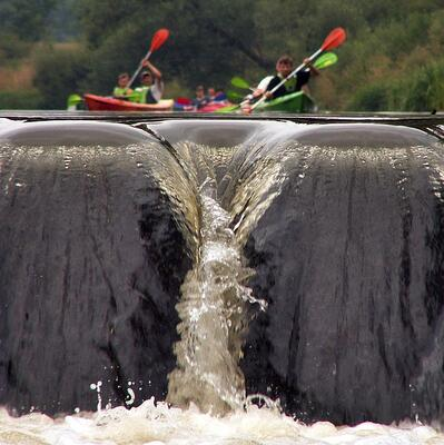 Kayak over a water fall
